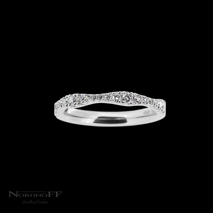 Handmade in platinum and set with a delicate and beautiful graduating wave of diamonds. This fitted wedding ring is shaped to sit closely next to the engagement ring but also with the added option that it can be worn alone and still look stunning!