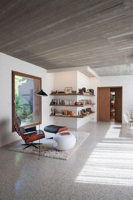 bookshelf wraps around a corner