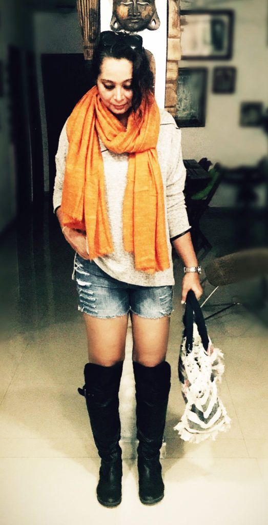 Don't pack away those shorts in winters.. Here's how you can style them into trendy winter outfits!!