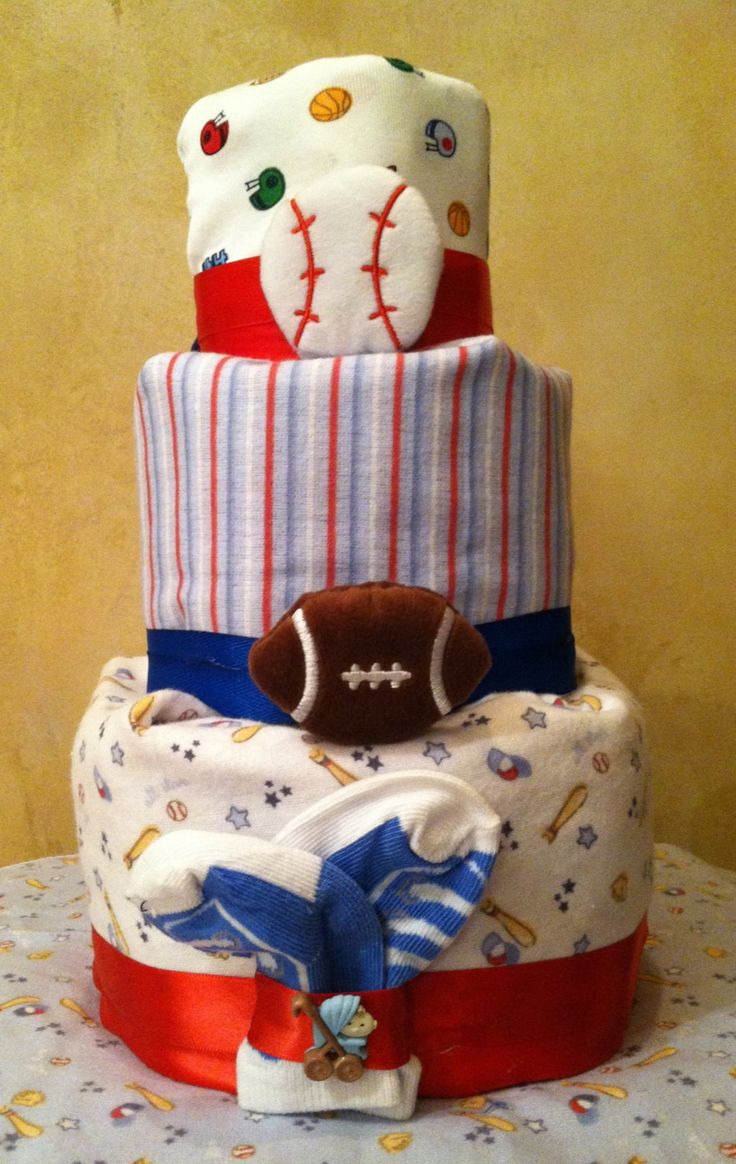 Sports Diaper Cake for baby boy....@Lindsay Snider this would be cute for your friends baby boy shower.