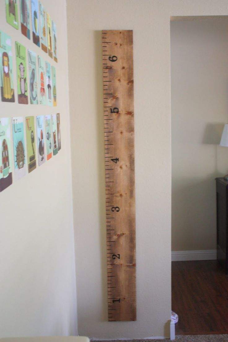 love the ruler idea to keep measurements as the kids grow. Place this onto a larger board and write the date & name of the child in ink and take a picture at that time.  A real growth chart!
