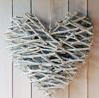 Heart (sticks, hot glue, & spray paint) (I can see this in natural colors, all kinds of shapes, for great rustic cabin decor, maybe incorporating other things - like a bird for a birdhouse shape, etc - can also see it as it is here with a bright red bow or poinsettia blossom or cardinal, or a bit of greenery or holly with berries, for Christmas decoration.)