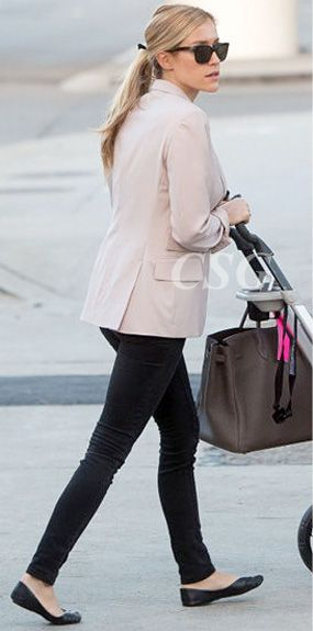 Kristin Cavallari looked effortlessly stylish in her soft-pink Alice + Olivia Elyse blazer when she and baby Camden arrived at LAX airport September 25, 2012