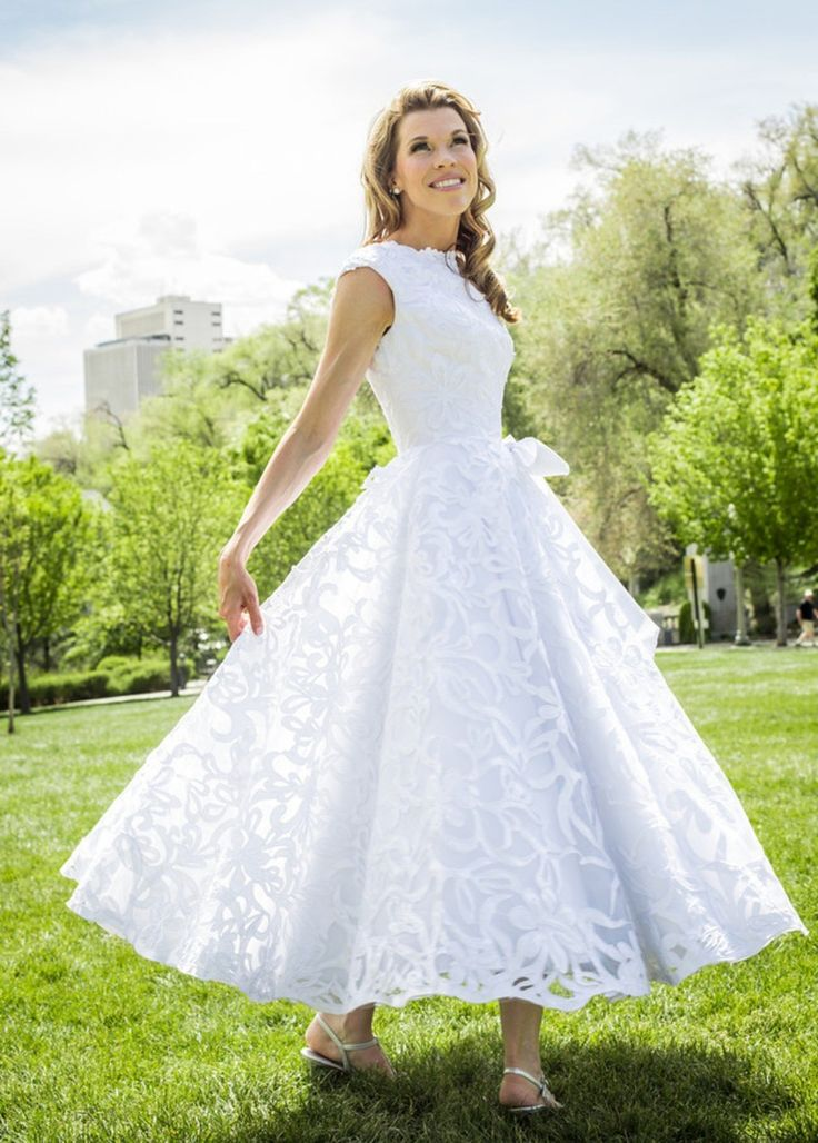 Gretha is one of a kind! Inspired by 1950's vintage wedding fashion, the full, round skirt is made for twirling. However, the most striking feature of the dress is the original, hand-cut satin lace. It is a time intensive process, but the results are amaz