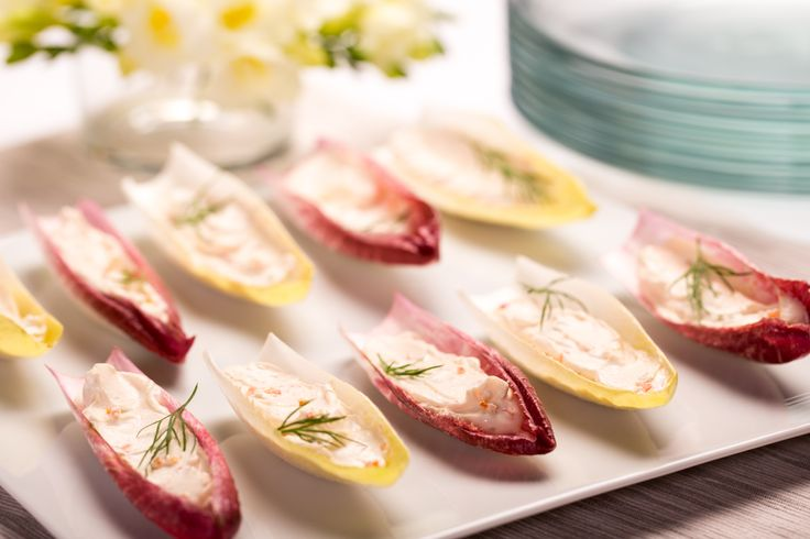 This easy appetizer with endive leaves and Garden Vegetable Cream Cheese Spread is perfect to decorate the table at any party.