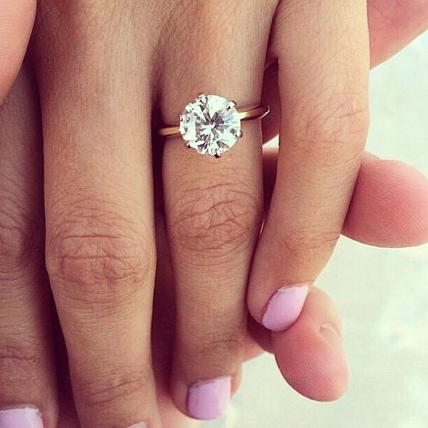 Stunning round solitaire. Would look amazing with a rose gold band.