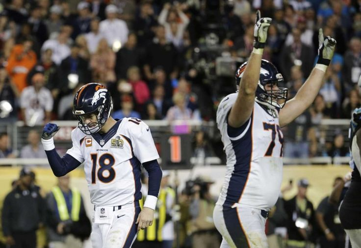 Denver Broncos quarterback Peyton Manning and tackle Michael Schofield celebrate a touchdown against the Carolina Panthers during the second half of Super Bowl 50 on Sunday, Feb. 7, 2016, in Santa Clara, Calif.