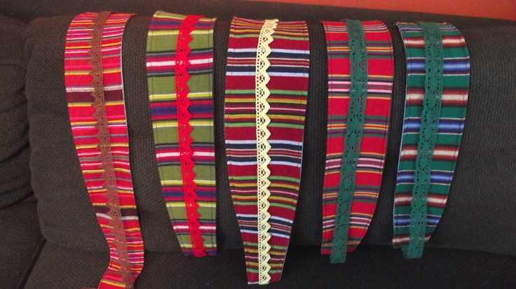 Belts made out of estonian look-a-lke folk costume materials, recycled jeans and lace/silk ribbons.  @http://www.facebook.com/Kansanomaisetkankaat