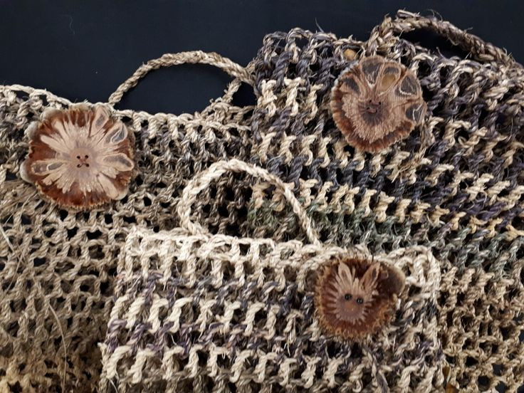 Little string bags made mostly with banana tree trunk fibre and embelished with Banksia seed buttons