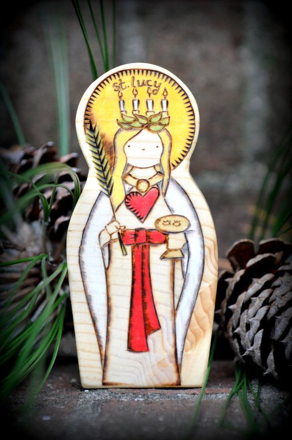 St. Lucy is Holy Spirit inspired, custom handmade, natural, beautiful, safe, and sure to inspire love and devotion to the saints. With each item, we spend a lot of time designing and hand-cutting our own patterns, sanding to a smooth silky finish so all the edges are rounded, wood-burning every little detail in place, then adding the wonderful colors with a non-toxic homemade milk paint, using a wash to penetrate the wood, so the beautiful grain will show through. We hand rub in a wonderful…