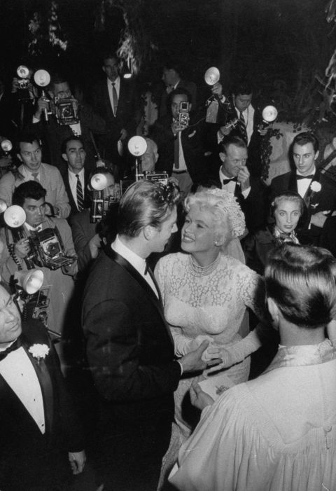 Though her divorce from Paul Mansfield had only been finalized days before, actress Jayne Mansfield wed Mickey Hargitay on January 13, 1958. The Mr. Universe winner had proposed to her with 10-carat diamond ring just two months prior.