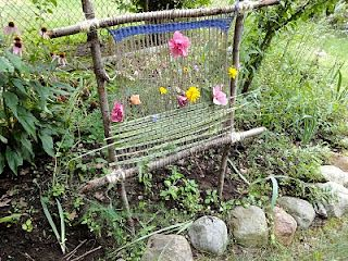 Seasonal Gnome: Garden Loom.  This is beautiful for summer grasses and flowers, but you could leave it up year-round and weave in autumn leaves or winter twigs with berries!