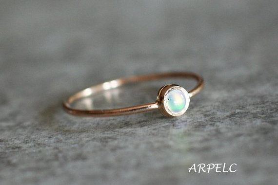 Fire opal ring, 14k gold opal ring, stacking ring, October birthstone.  Excellent as a gift, especially for those who are born in October.  This opal ring can be paired with other rings because of the bezel setting on the top of the ring.  CENTRAL STONE:  *natural, Earth mined opal *quality: AAA *opal is October birthstone *shape: round *colour: fire opal *the setting around the stone is hammered *diameter: 3 mm   SPECIFICATIONS:  *band: 0.9 mm, high polish * material: 14k yellow gold, Eco…