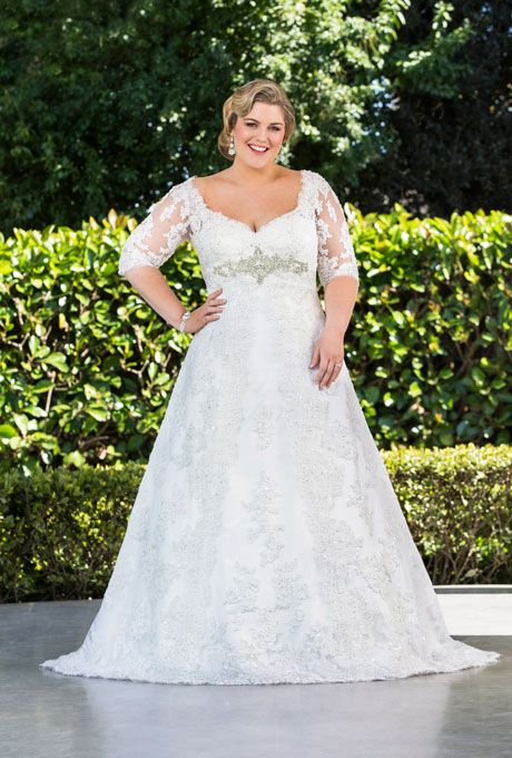 """Brides.com: Designer Plus-Size Wedding Dresses We Love. Style 5730T, """"Ava"""" Glamour Plus Collection small A-line corded Chantilly lace gown with lace high back neck, price upon request, Roz la Kelin  See more A-line wedding dresses."""