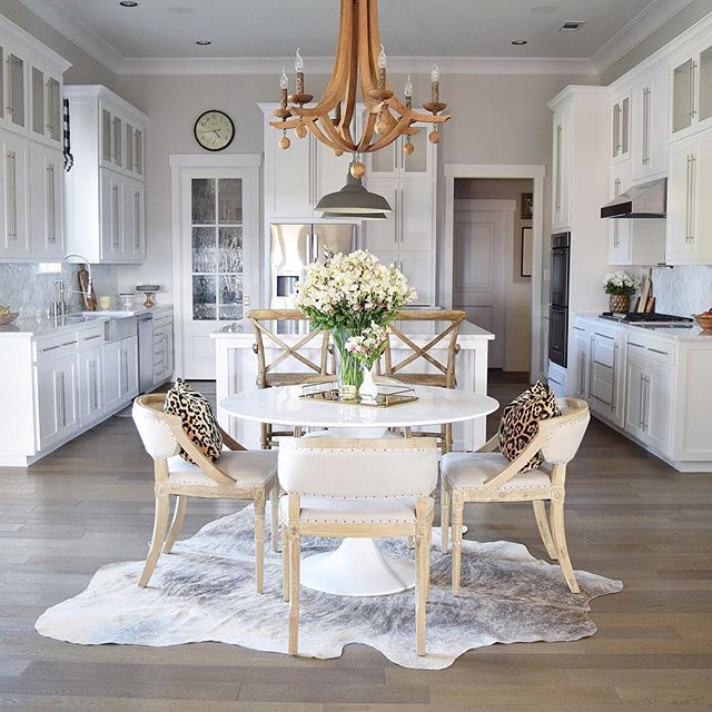 White kitchen design with in kitchen dining and wooden chandelier | Z Design At Home