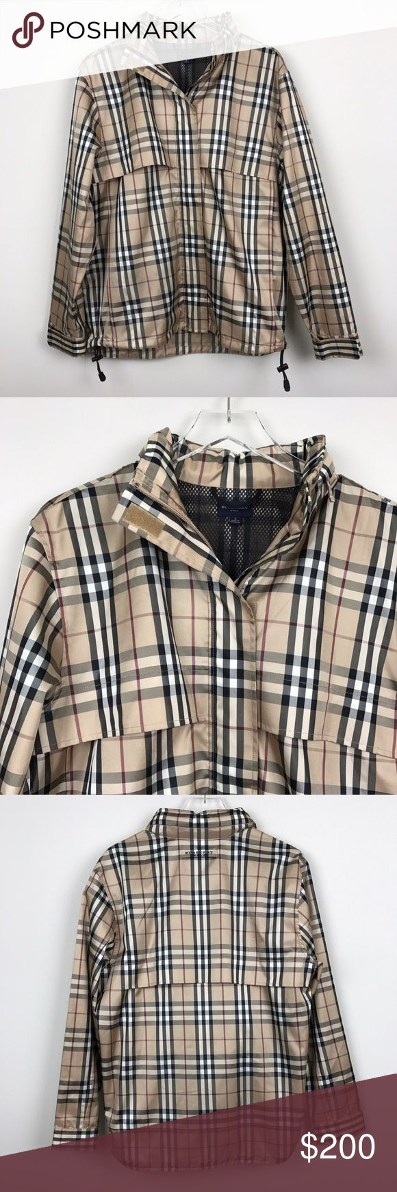 """[Burberry] Golf Nova Check Plaid Rain Jacket Hood Women's Burberry Golf jacket. Lightweight water resistant. Zip front. Adjustable tab cuff closures. Adjustable drawstring toggle hem. Vented. Hidden hood in collar. Logo embroidery at back of neck. Classic Nova Check Plaid.  🔹Pit to Pit: 22"""" 🔹Length: 28"""" 🔹Sleeve Length: 25"""" 🔹Shoulders: 18"""" 🔹Condition: Excellent pre-owned condition. No flaws.  *AI5 Burberry Jackets & Coats"""