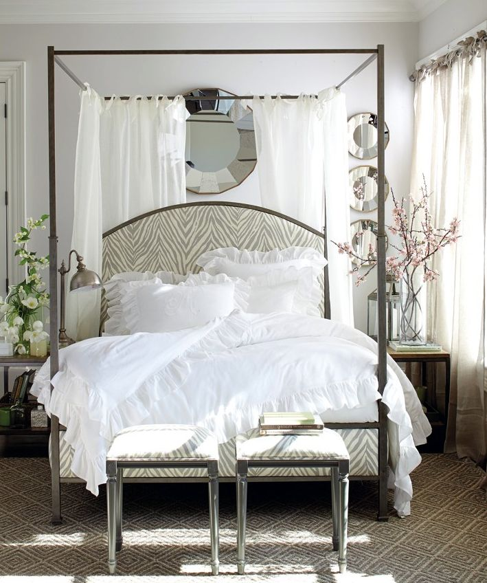 White Bedroom With Zebra Upholstered Canopy Bed