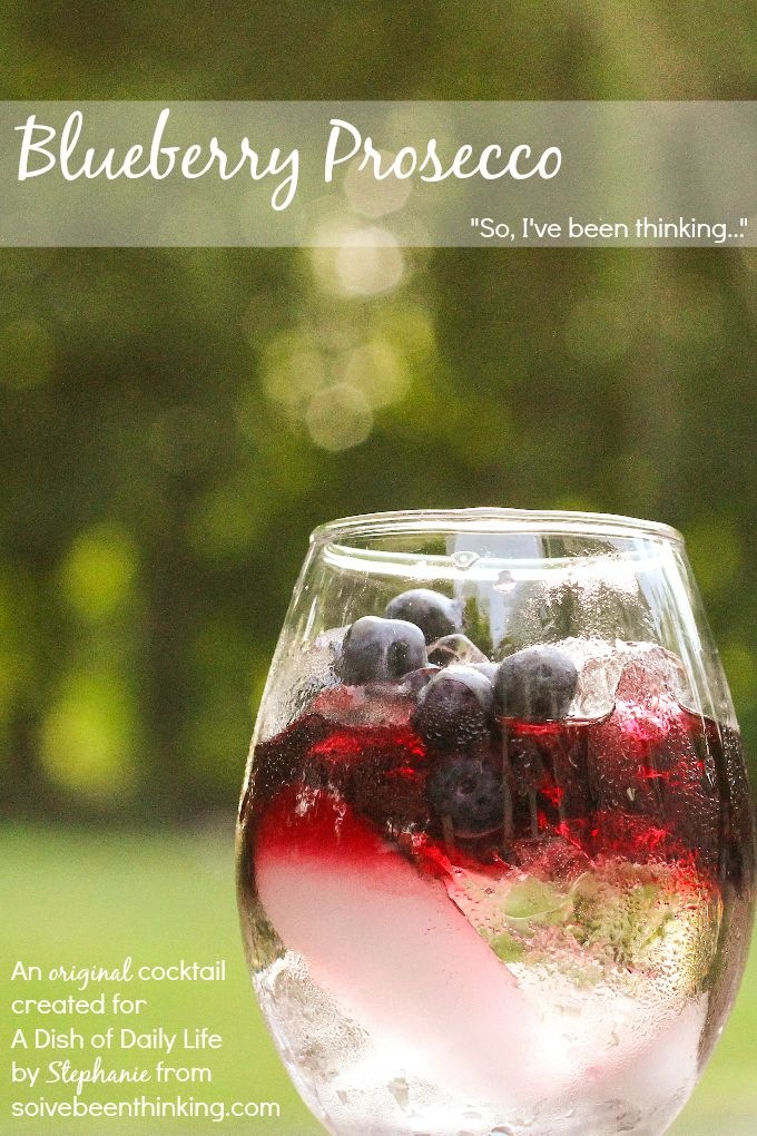 Blueberry Prosecco...blueberry vodka layered over your favorite prosecco, and garnished with fresh blueberries, raspberries, strawberries and cherries for a fun red, white and blue cocktail recipe.