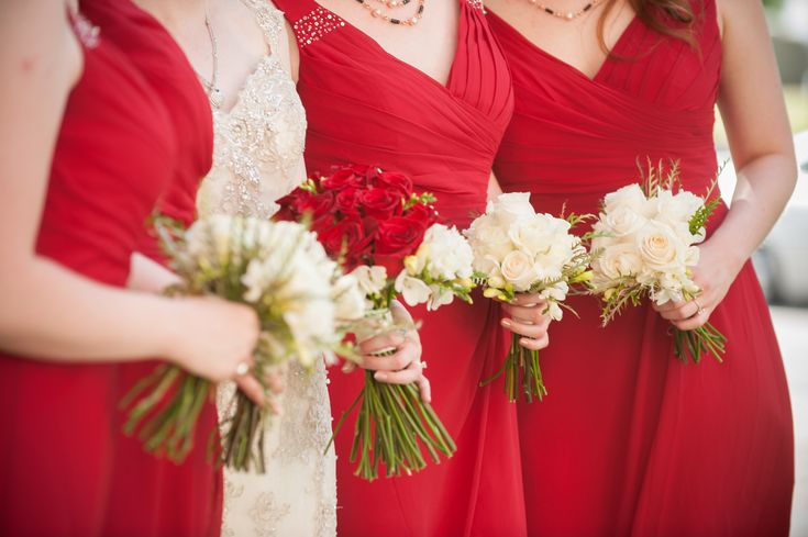 Red bridesmaids dresses accented with white bouquets - Jerrod Brown Studios