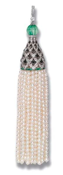AN EXQUISITE ART DECO DIAMOND, ONYX, EMERALD AND NATURAL PEARL PENDANT The pearl tassle suspended from an openwork diamond, onyx and emerald cap to the emerald bead top and diamond hoop, circa 1920, 11.5 cm. long, with French assay mark for platinum, no. 4286.