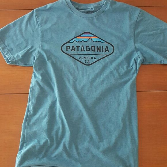 Patagonia T-Shirt Men's Small. I am an XS woman but bought it because the Patagonia Women's T-shirt designs are terrible. Fits fine, it's just long. Worn a couple of times, no stains. Patagonia Tops Tees - Short Sleeve