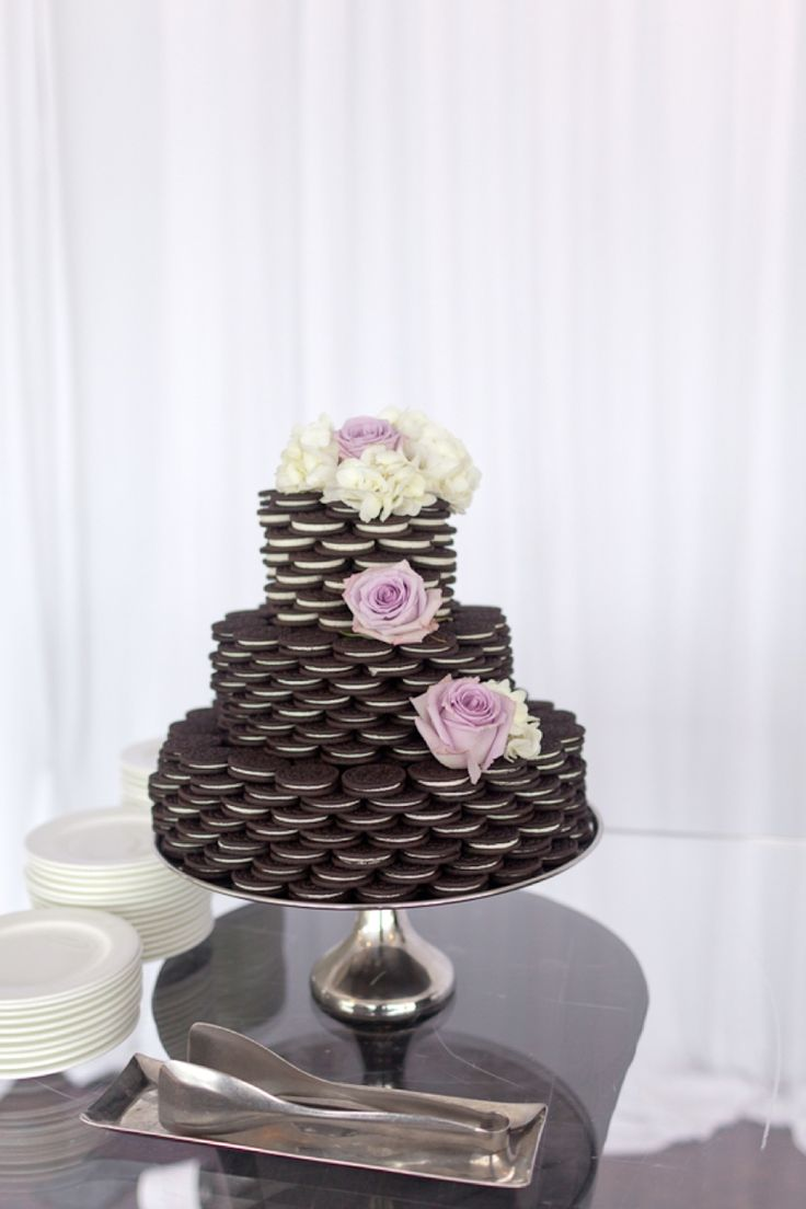 Are those Oreos!? YUM! How about that instead of a wedding cake? And it looks to pretty too!  Photo by Andi Mans Photography.