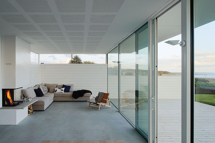 Modern Swedish family dream getaway with Sits sofa and Borge Mogensen chair in the living room