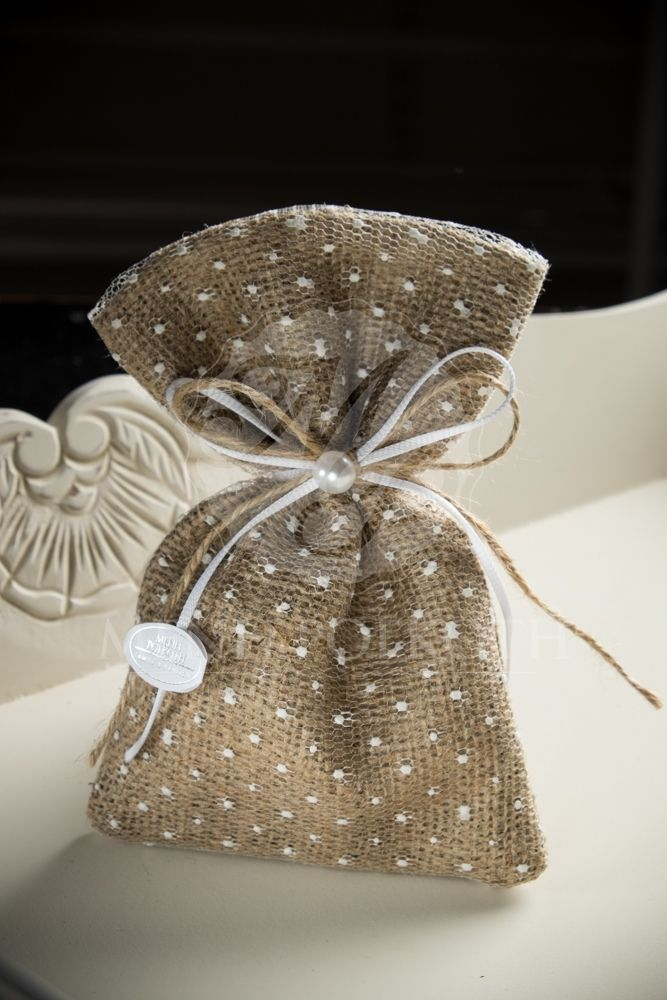 Shabby chic burlap pouch with polka dot tulle layer, tied with bow and decorated with half pearl. #shabbychicfavor #burlapfavor #romanticwedding