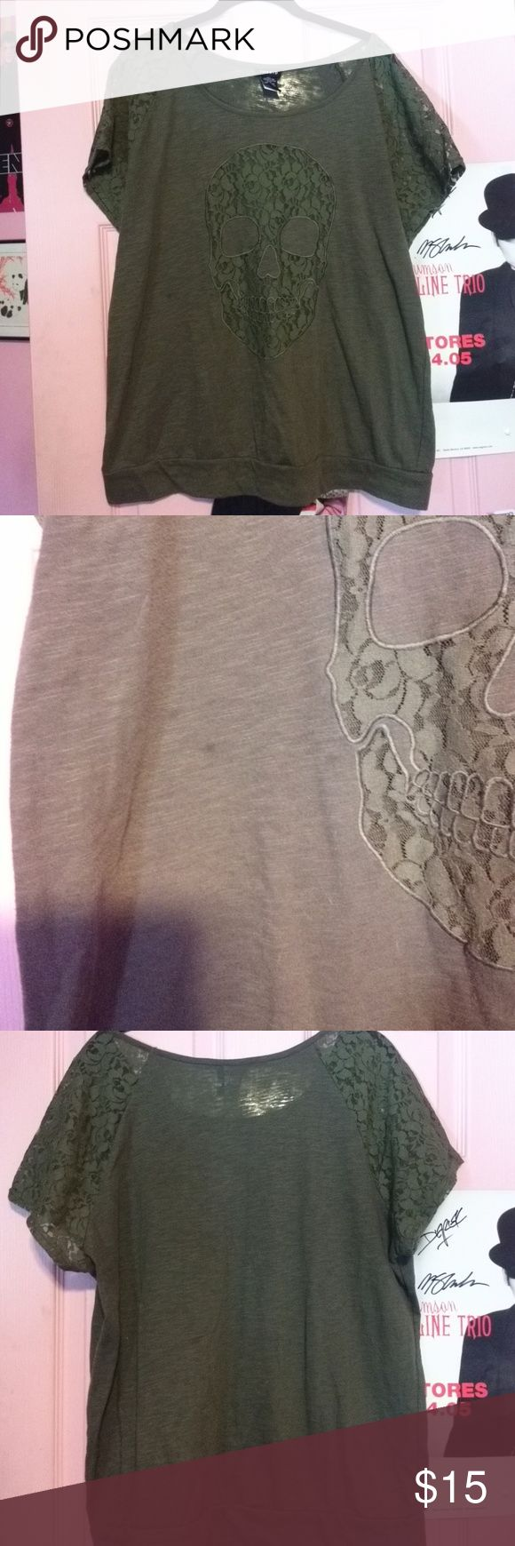 Torrid Lace Skull and Sleeves Blouse A cool olive green top with a lace skull and sleeves. The skull is see-through so you'll need to wear a family underneath. There are a few spots on the front and back from wear but not too noticeable. Size 0. torrid Tops Blouses