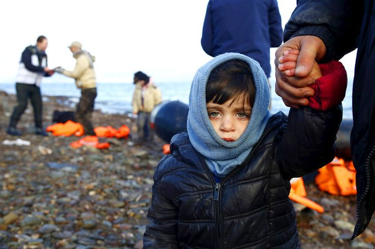 A Syrian refugee child looks on, moments after arriving on a raft with other Syrian refugees on a beach on the Greek island of Lesbos on January 4th.