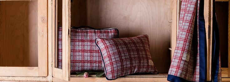 Plaid fabric in slate gray and red express a vibrant style with a refined character. Discover Red Lychee Gramercy Collection.