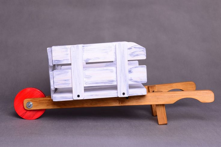 Wooden barrow photography prop with spinning wheel and stable construction. This prop is perfect for newborn baby and toddler photographer. Great for spring and summer photo session :)