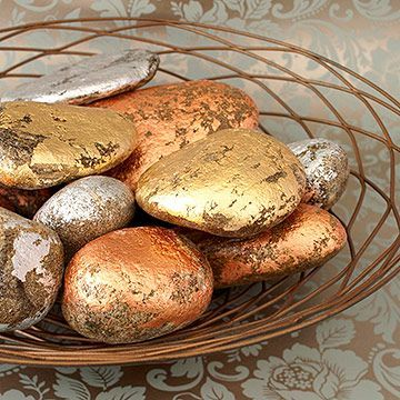 For a more modern Thanksgiving table, make over ordinary rocks with gold, silver, and copper leaf (available at crafts stores). Leave some of the rocks' surfaces exposed to create an eye-catching pattern.