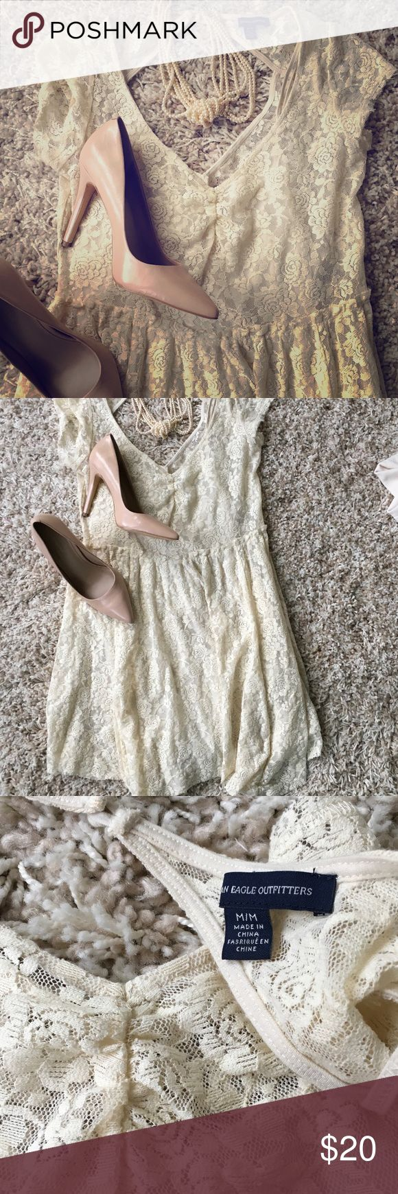 """American Eagle Outfitters Short sleeve lace dress Short sleeve lace dress with really cute back detail. Handkerchief hem 28"""" long at shortest point and 33"""" at longest point. Fully lined. Worn but in good condition. Price is firm unless bundled. American Eagle Outfitters Dresses"""