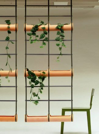 Deco Flower Pots--Treille is a unique system of cylindrical vases, horizontally aligned and connected by nylon belts and adjustable suspenders. The pre-assembled set hangs from ceilings, edges, woodworks, etc (hanging brackets included). The plants find easy ways to grow vertically in either direction.