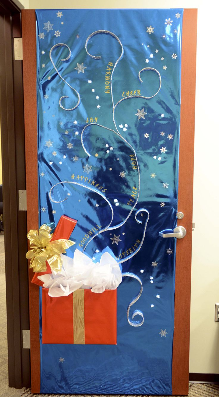 office door decoration christmas theme | This is a photo of a decorated door.