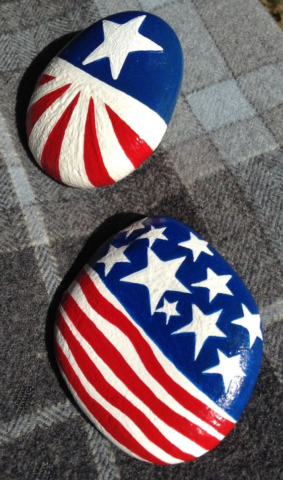 Hand Painted Rocks (2) - Celebrate our great Nation! Add a little 4th of July flare to your picnic table or party decorations. Show your support for the old Red, White, and Blue. Each rock is approximately 2 x 2 and 1 in height.