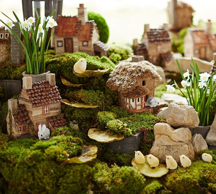 "Easter Village ~ charming cottages made of natural materials (moss, stone, wood, banana leaf, pine cones) in 3 sizes, each a different style (largest is 8x10"" base & 9.5""h), $49.50 each 