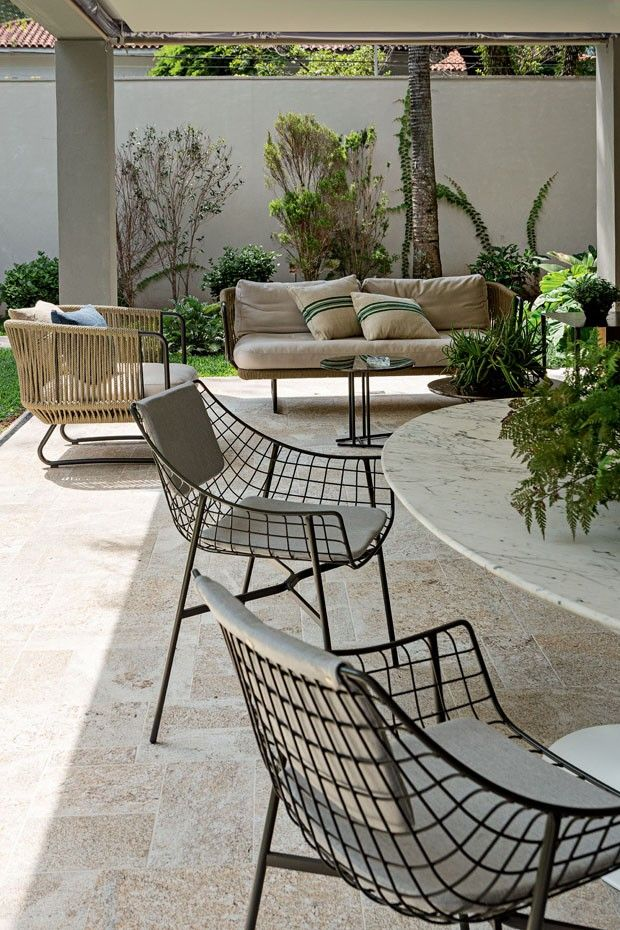 Refurbishment of Cottage in Sao Paolo Brasil. Terrace furbished with Summerset and Babylon design Christophe Pillet for Varaschin http://www.varaschin.it/products/outdoor/armchairs/summer-set-lounge-chair-seat-cushion-59586.html