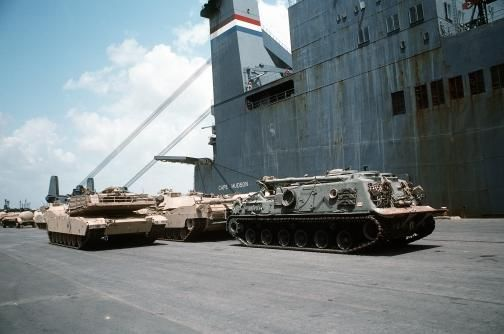 Image 27/30  An M-88A1 armored recovery vehicle, right, and two M-1A1 Abrams main battle tanks sit on the pier after being unloaded from the Military Sealift Command-chartered vehicle cargo ship CAPE HUDSON (T-AKR-5066), La Porte, TX, 19 July 1991. The CAPE HUDSON transported vehicles and other equipment back from the Persian Gulf region, where they were used during Operation Desert Shield and Operation Desert Storm.
