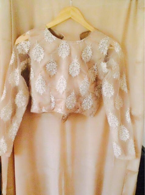 Beautiful beige plain chinon chiffon saree with elegant full sleeves blouse. For further enquiries whatsapp 9829126274