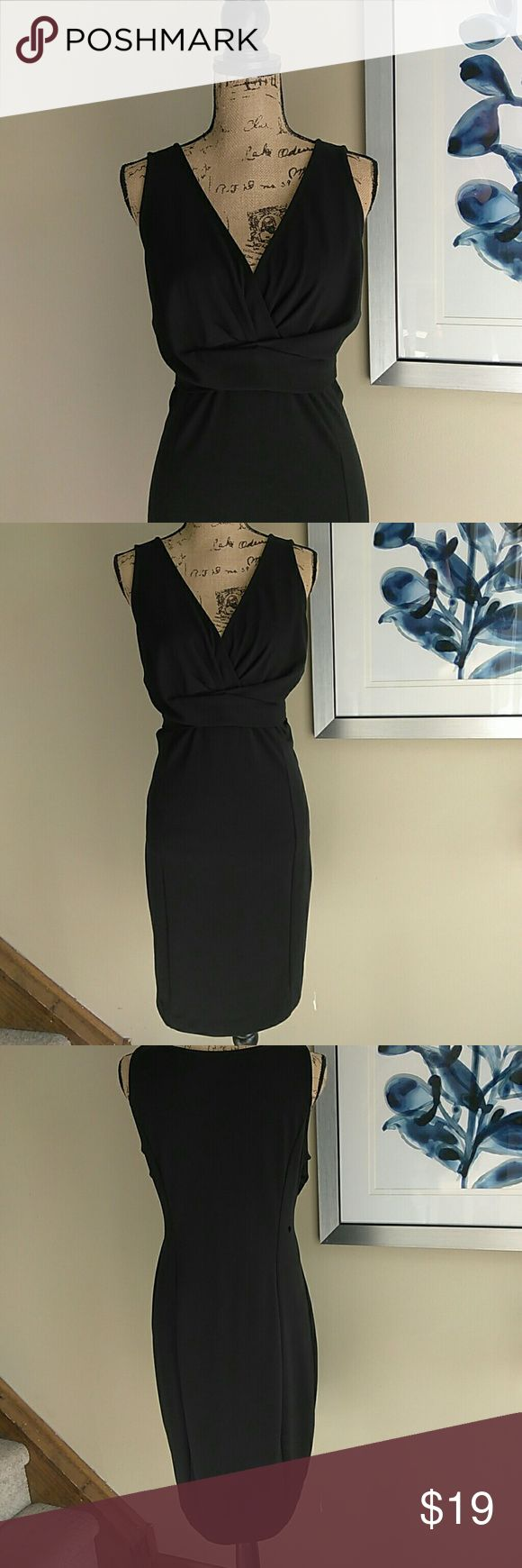 Sexy Little Black Dress Size Large LBD Daisy Fuentes Sexy Little Black Dress. Size Large. Sexy LBD. Sleeveless black dress. Cute gather detail under burst to flatter your tummy & give you a sleek silhouette. In amazing condition! No stains, rips, tears, or holes. Feel free to ask any questions. MAKE ME AN OFFER! FREE GIFT with every purchase! Bundle for further discounts. Daisy Fuentes Dresses