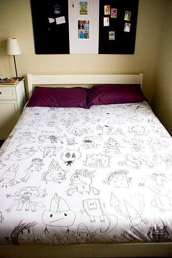 She saved her son's artwork, photographed it, turned it black and white, increased the size, and traced it onto a plain white duvet cover.