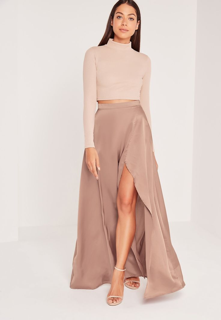 Unleash your inner Diva with this nude satin split side maxi skirt. The luxe satin fabric looks hella expensive and simple divine, while the side split looks totally mesmerising and will show off your pins in all of their glory. Wear with a...