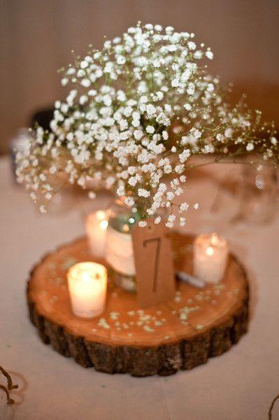 Rustic chic wedding centerpiece idea - baby's breath flower arrangement + votives on a wooden slice {Swanky Fine Art Weddings}