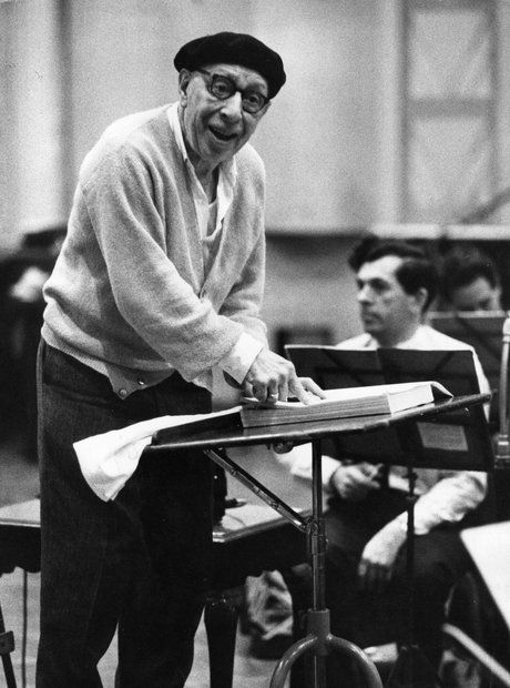 Igor Stravinsky preparing to conduct at a rehearsal.
