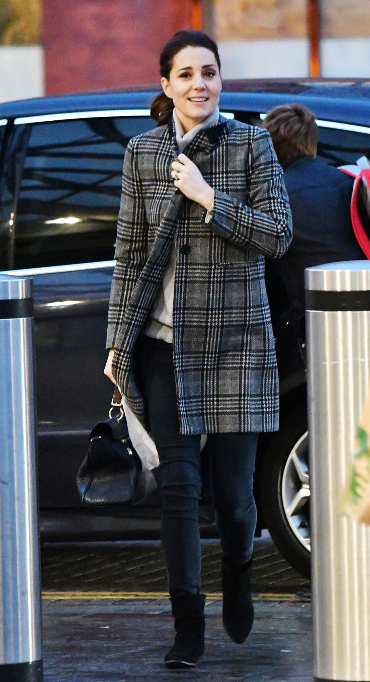 Pregnant Kate Middleton Covers Her Baby Bump in a Patterned Zara Coat | The royal was seen during an unofficial trip to London's St. Pancras station.