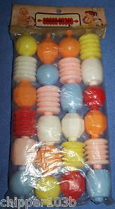 Large snap beads. Have old home movies showing me playing with these when I was only around 1 year old. Had gotten them for Christmas and loved them!