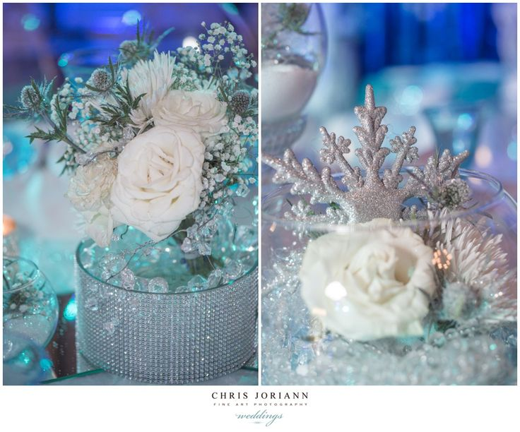 Beautiful snowflake and white roses winter wonderland table centerpieces. Perfect for a winter themed sweet 16 birthday party.