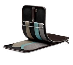 Ties Only Ties Only travel case. Folding holster keeps ties neat and protected during travel. Leather snap fastener allows for straight hanging in closets. Holder in metal with anti-slip rubber so ties stay in place. Holds 6 ties, accommodates extra long ties. Ref. H062031CK46 $2,150.00